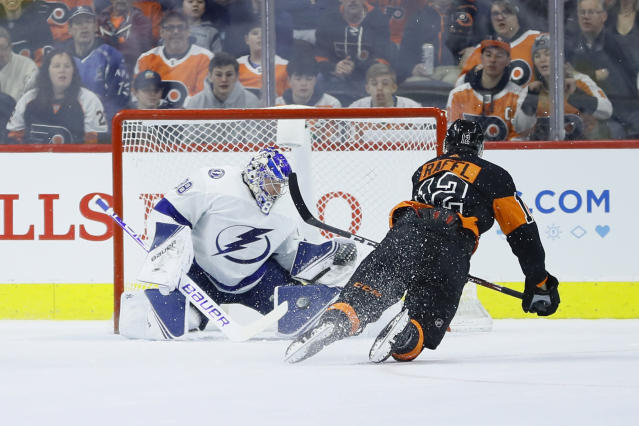 Tampa Bay Lightning's Andrei Vasilevskiy, left, blocks a shot by Philadelphia Flyers' Michael Raffl during the first period of an NHL hockey game, Saturday, Jan. 11, 2020, in Philadelphia. (AP Photo/Matt Slocum)