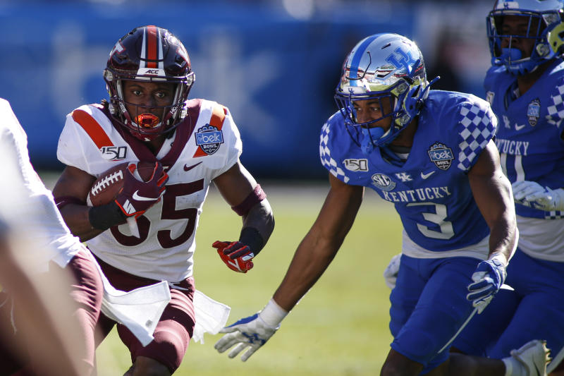 Virginia Tech running back Keshawn King, left, carries the ball as Kentucky safety Jordan Griffin (3) tries to make the tackle in the first half of the Belk Bowl NCAA college football game in Charlotte, N.C., Tuesday, Dec. 31, 2019. (AP Photo/Nell Redmond)