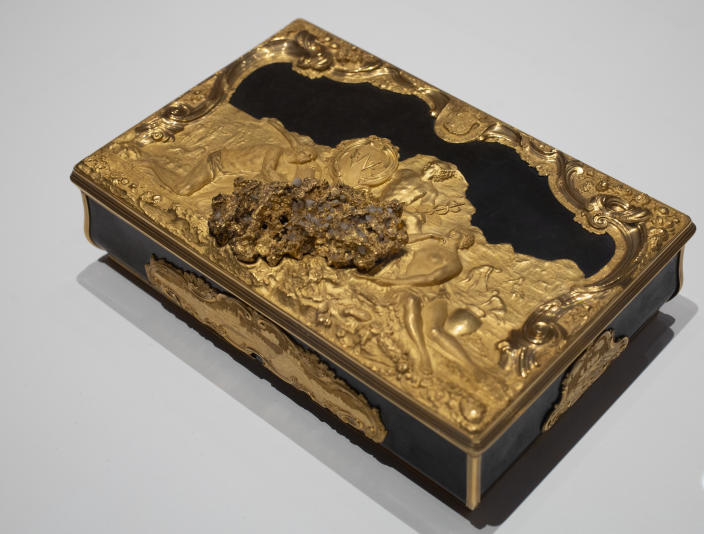 """A box gifted to Stadholder William IV as the new governor of the Dutch West India Company (WIC) with decorations referring to the WIC's trade in gold, ivory and people, is displayed at the Slavery exhibition at the Rijksmuseum in Amsterdam, Netherlands, Monday, May 17, 2021. The stark contrast between finery and brutality, wealth and inhumanity is a recurring pattern at the museum's unflinching new exhibition titled, simply, """"Slavery"""", that examines the history of Dutch involvement in the international slave trade. (AP Photo/Peter Dejong)"""