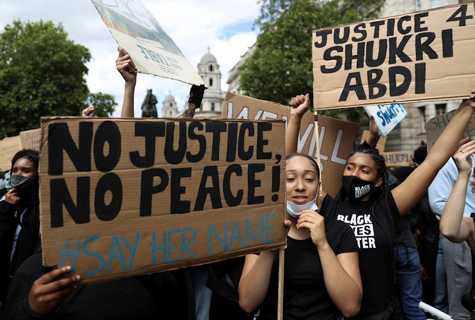 "People gather during a demonstration called ""Justice for Shukri Abdi"" in London, Britain, June 27, 2020. REUTERS/Simon Dawson"