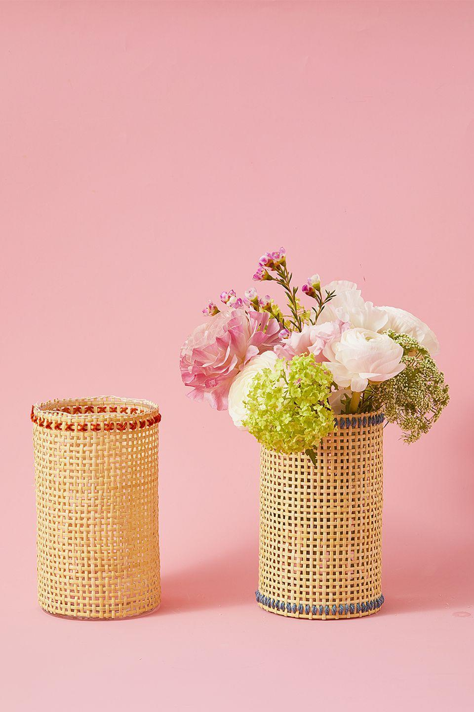 """<p>Pick flowers straight from your garden and stick them inside this boho-inspired vase. To make, cut a piece of cane webbing to fit around a glass hurricane vase. Thread a needle with contrasting yarn or embroidery thread and stitch a line or criss cross pattern along the edges. Wrap the webbing around the vase and adhere with hot glue.</p><p><a class=""""link rapid-noclick-resp"""" href=""""https://www.amazon.com/Pressed-Cane-Webbing-splines-Instructions/dp/B07XQZ47QF/?tag=syn-yahoo-20&ascsubtag=%5Bartid%7C10055.g.1906%5Bsrc%7Cyahoo-us"""" rel=""""nofollow noopener"""" target=""""_blank"""" data-ylk=""""slk:SHOP CANE WEBBING"""">SHOP CANE WEBBING</a></p>"""