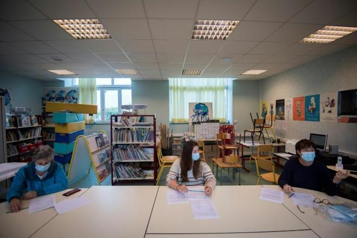 Teachers at a school on France's Groix island attended a meeting on Monday to organise its reopening (AFP Photo/Loic VENANCE)
