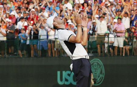 Martin Kaymer of Germany reacts after sinking his putt on the 18th green during the final round of the U.S. Open Championship golf tournament in Pinehurst