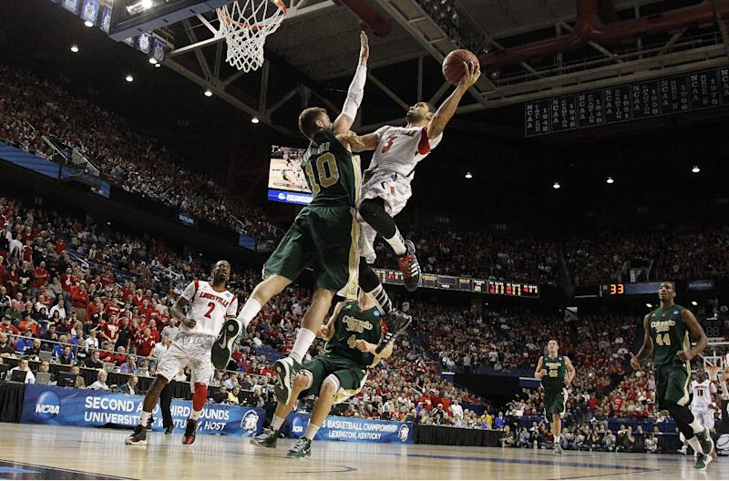Louisville guard Peyton Siva (3) shoots as Colorado State's Wes Eikmeier defends in the first half of a third-round NCAA college basketball tournament game on Saturday, March 23, 2013, in Lexington, Ky. (AP Photo/John Bazemore)