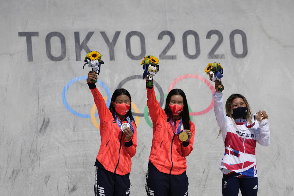From left, silver medalist Kokona Hiraki of Japan, gold medalist Sakura Yosozumi of Japan and bronze medalist Sky Brown of Britain pose during a medals ceremony for the women's park skateboarding at the 2020 Summer Olympics, Wednesday, Aug. 4, 2021, in Tokyo, Japan. (AP Photo/Ben Curtis)