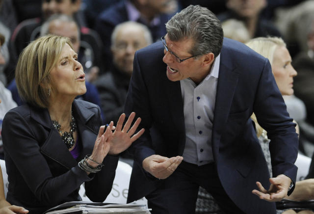FILE - In this Feb. 29, 2016, file photo, Connecticut head coach Geno Auriemma, right, reacts toward associate head coach Chris Dailey in the first half of an NCAA college basketball game against South Florida, in Storrs, Conn. Connecticut assistant coach Chris Dailey and former Tennessee assistant Mickie DeMoss are breaking new ground this weekend when they get inducted into the Women's Basketball Hall of Fame. This marks the first time in the organization's 20-year history that it has inducted anyone based on accomplishments as an assistant coach. (AP Photo/Jessica Hill, File)