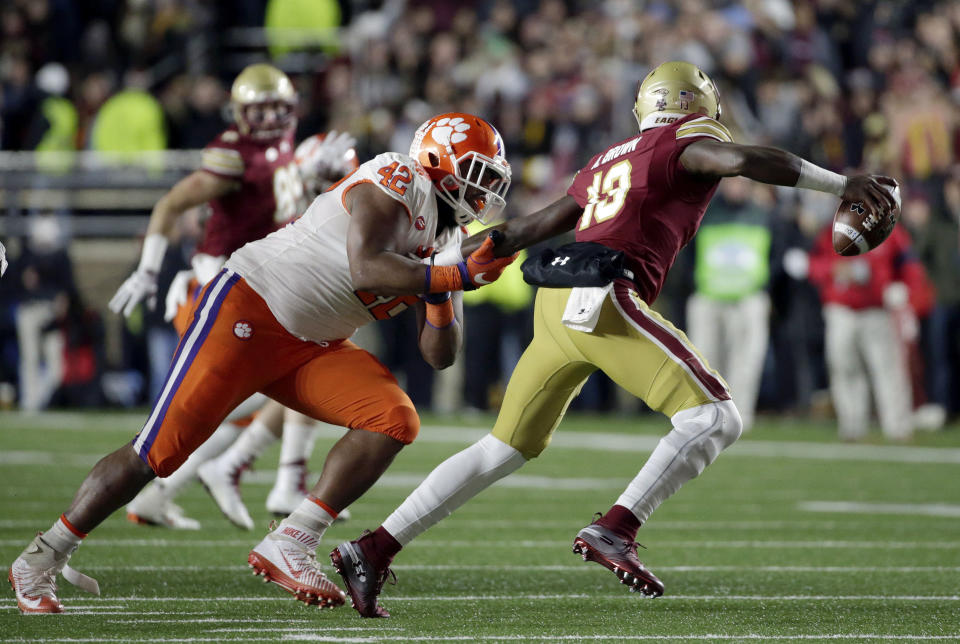Clemson defensive lineman Christian Wilkins, left, tackles Boston College quarterback Anthony Brown during the first half of an NCAA college football game Saturday, Nov. 10, 2018, in Boston. (AP Photo/Elise Amendola)