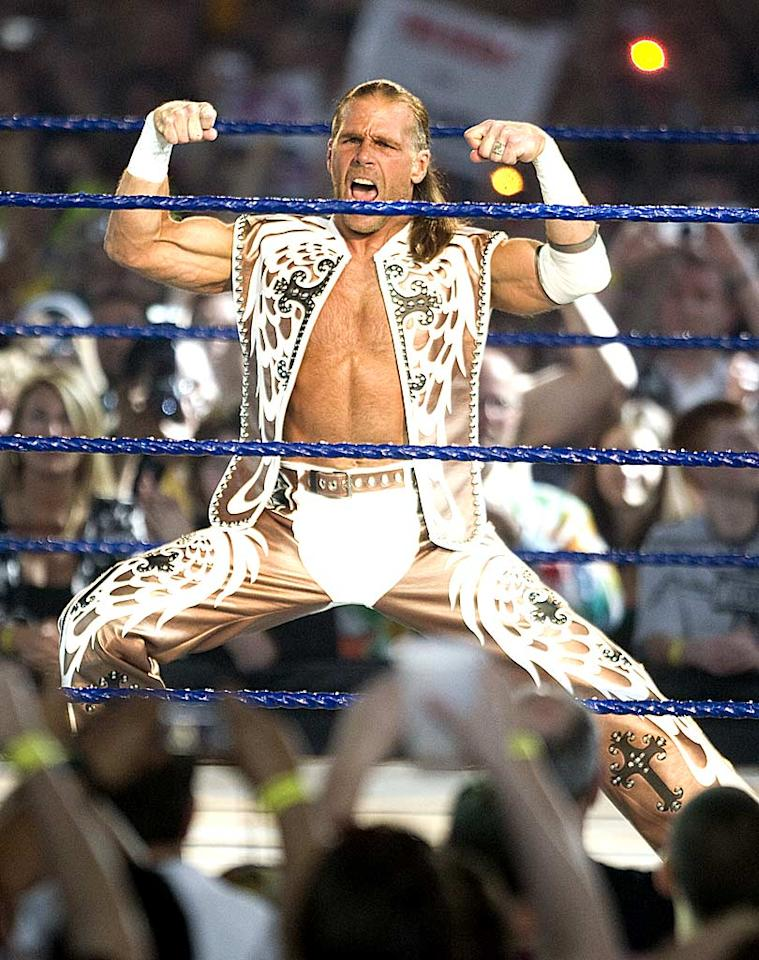 "Shawn Michaels sported a patterned vest and matching chaps. Unfortunately, the Texan's trademark ensemble didn't distract his opponent, The Undertaker, who pinned ""The Heartbreak Kid"" following a Tombstone piledriver. Bob Levey/<a href=""http://www.wireimage.com"" target=""new"">WireImage.com</a> - April 5, 2009"