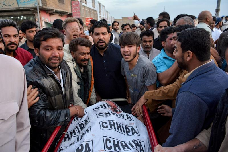 Pakistani Christians mourn the death of relatives who were killed in a drive-by shooting outside a church, at a hospital in Quetta on April 15, 2018