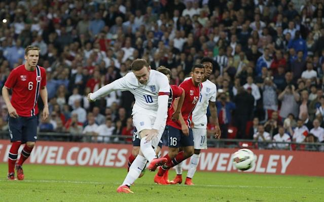 England's Wayne Rooney shoots and scores from the penalty spot during the international friendly soccer match between England and Norway at Wembley Stadium in London, Wednesday, Sept. 3, 2014. (AP Photo/Alastair Grant)