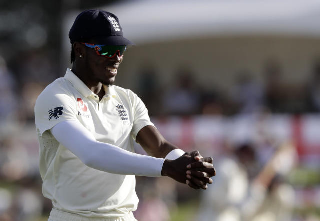 England's Jofra Archer stretches as he prepares to bowl during play on day two of the first cricket test between England and New Zealand at Bay Oval in Mount Maunganui, New Zealand, Friday, Nov. 22, 2019. (AP Photo/Mark Baker)