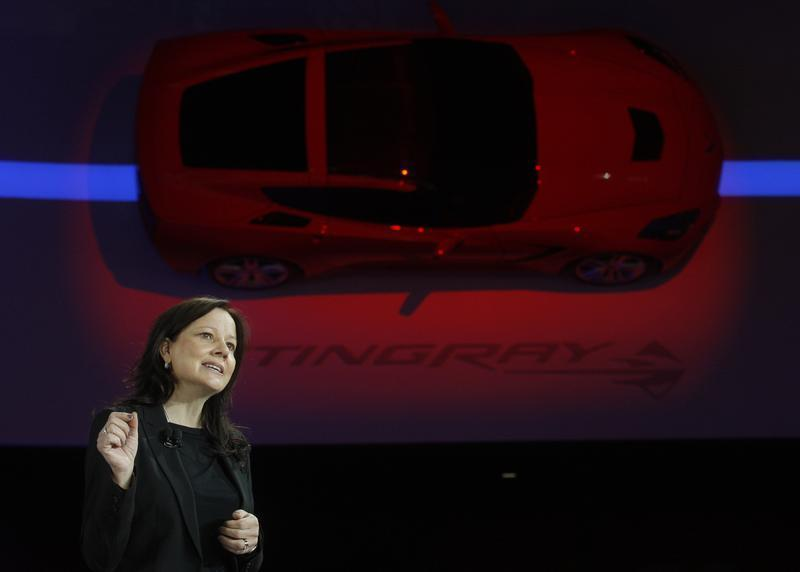 Mary Barra, Senior VP of General Motors Global Product Development, speaks near a 2014 Corvette Stingray at the North American International Auto Show in Detroit