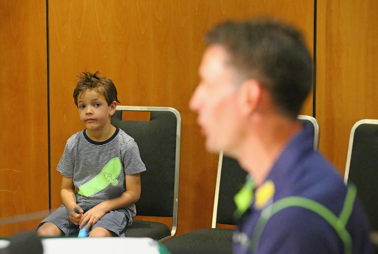 MELBOURNE, AUSTRALIA - DECEMBER 30:  William Hussey, the son of Michael Hussey of Australia watches his dad during at a press conference on December 30, 2012 in Melbourne, Australia.  Mike Hussey has announced that the third Vodafone Test against Sri Lanka in Sydney will be his last Test for Australia.  (Photo by Scott Barbour/Getty Images)
