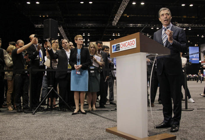 NATO Secretary General Anders Fogh Rasmussen speaks to the media before government and world leaders arrive at the NATO Summit in Chicago Sunday, May 20, 2012. (AP Photo/Carolyn Kaster)