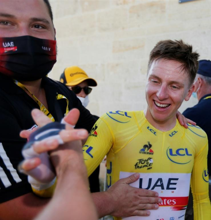Tadej Pogacar all smiles after his eighth place on the stage effectively won the Tour
