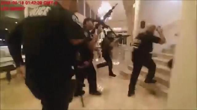 Bodycam video released Monday night by the Miami-Dade Police Department shows the drama that unfolded as police fired shots during their search for a gunman who'd opened fire inside Trump National Doral Miami resort early Friday morning. Rough cut (no reporter narration).