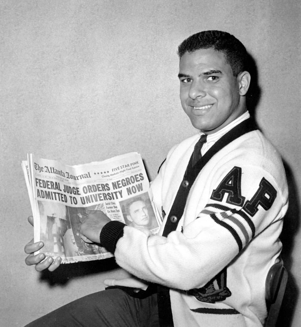 Hamilton E. Holmes, 19, displays The Atlanta Journal's headlines on Jan. 6, 1961, after he and Charlayne Hunter, 18, were ordered admitted immediately to the University of Georgia, an all-white college. U.S. District Judge W.A. Bootle ruled that they had been denied admission because of race. Holmes was a pre-med student at Morehouse College in Atlanta. Hunter was studying journalism at Wayne State University in Detroit.