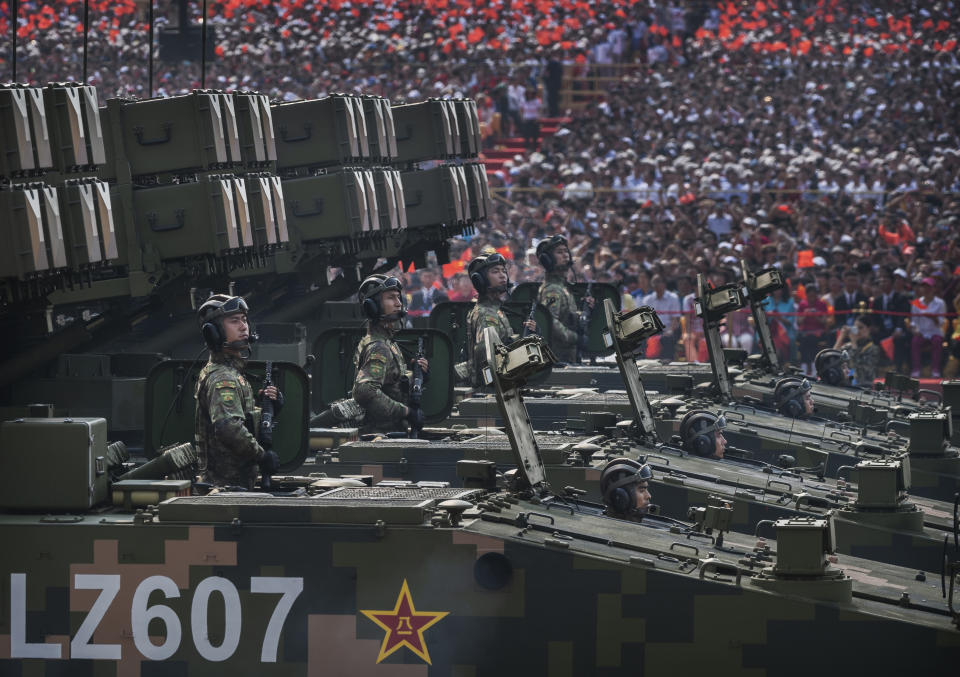 Chinese soldiers sit atop mobile rocket launchers inn 2019 during a parade to celebrate the 70th Anniversary of the founding of the People's Republic of China. Source: Getty