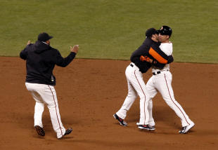Giants pitcher Jake Peavy (center) hugged Ishikawa before he had even reached third on his homer. (USA Today)