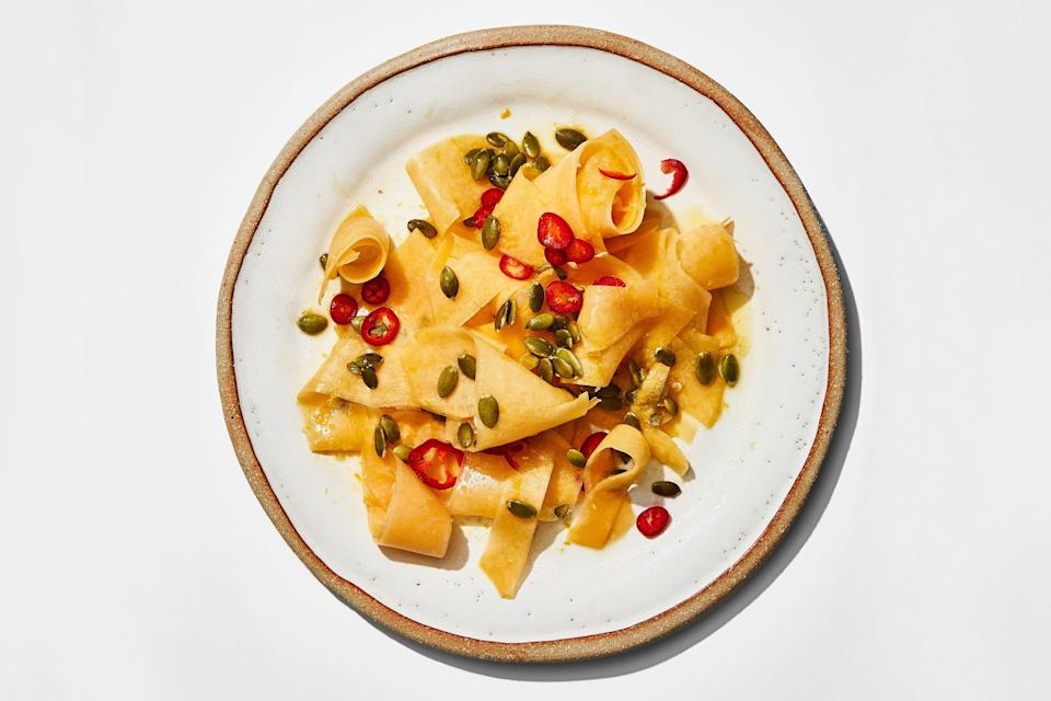 """Yes, you can eat butternut squash raw: Thinly shave it into ribbons and marinate it in a zesty dressing and it's a refreshing and fun new side for Thanksgiving. <a href=""""https://www.epicurious.com/recipes/food/views/raw-butternut-squash-ribbon-salad-with-orange-and-chile?mbid=synd_yahoo_rss"""" rel=""""nofollow noopener"""" target=""""_blank"""" data-ylk=""""slk:See recipe."""" class=""""link rapid-noclick-resp"""">See recipe.</a>"""