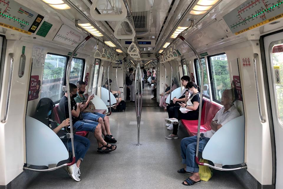 People wearing face masks while travelling aboard an East-West Line train on 7 April 2020, the first day of Singapore's month-long circuit breaker period. (PHOTO: Dhany Osman / Yahoo News Singapore)