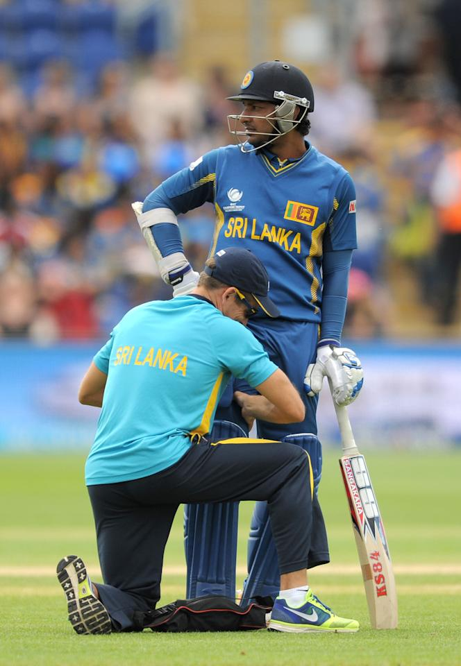 Sri Lanka's Kumar Sangakkara receives treatment for an injury during the ICC Champions Trophy match at the SWALEC Stadium, Cardiff.