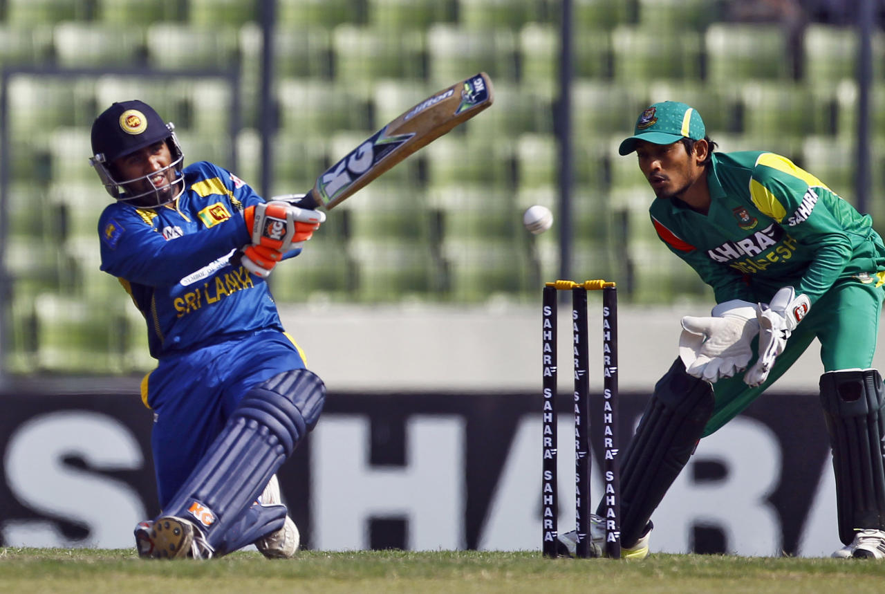 Sri Lanka's Ashan Priyanjan, left, plays a shot as Bangladeshi Anamul Haque watches during the second one day international (ODI) cricket match between them in Dhaka, Bangladesh, Thursday, Feb. 20, 2014. (AP Photo/A.M. Ahad)