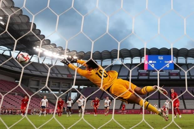 Goalkeeper Adrianna Franch of the United States can't save a penalty from Jessie Fleming of Canada, right. The London, Ont., native's goal was the only one in the Olympic women's semifinal Monday at Kashima Stadium in Japan. (Naomi Baker/Getty Images - image credit)