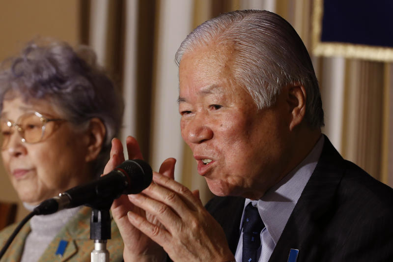 FILE - In this March 24, 2014, file photo, Shigeru Yokota, the father of Megumi Yokota who was abducted by North Korea in 1977, speaks as his wife Sakie listens during a news conference at the Foreign Correspondents' Club of Japan in Tokyo. Shigeru Yokota died of natural causes before he was able to meet his daughter again, his group said Friday, June 5, 2020. He was 87. (AP Photo/Shizuo Kambayashi, File)