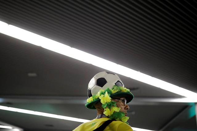 A Brazilian soccer fan arrives at the Sochi, Russia, airport ahead of the World Cup, June 13, 2018. (Photo: Carlos Barria/Reuters)