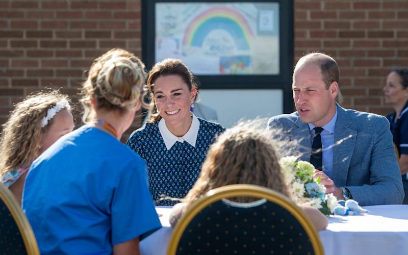 The Duke and Duchess of Cambridge meeting nurse Suzie Vaughan and daughters Hettie and Bella - PA