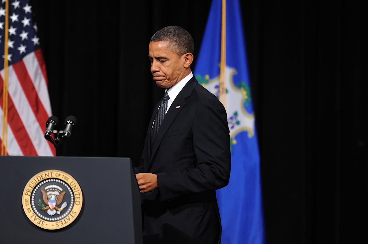 NEWTOWN, CT - DECEMBER 16:  U.S. President Barack Obama walks to the podium to speak at an interfaith vigil for the shooting victims from Sandy Hook Elementary School on December 16, 2012 at Newtown High School in Newtown, Connecticut. Twenty-six people were shot dead, including twenty children, after a gunman identified as Adam Lanza opened fire at Sandy Hook Elementary School. Lanza also reportedly had committed suicide at the scene. A 28th person, believed to be Nancy Lanza, found dead in a house in town, was also believed to have been shot by Adam Lanza. (Photo by Olivier Douliery-Pool/Getty Images)