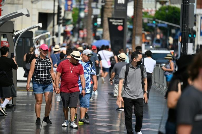 Tourists walk on Hollywood Boulevard's Walk of Fame (AFP/Robyn Beck)