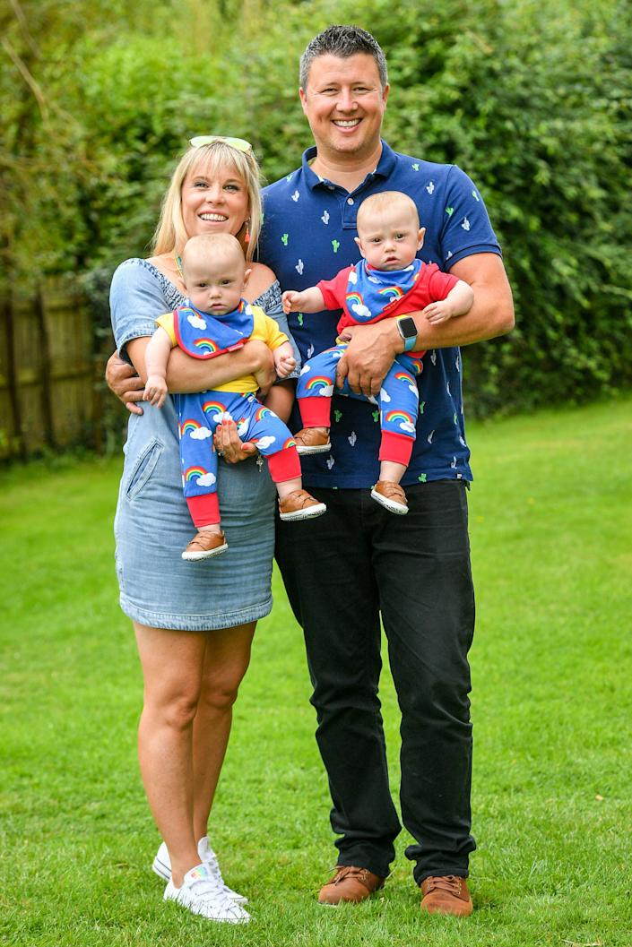 Jennie and Rich Powell with their twin boys Ruben (left) and Jenson, who are celebrating their first birthday by meeting HM Coastguard crews (PA)