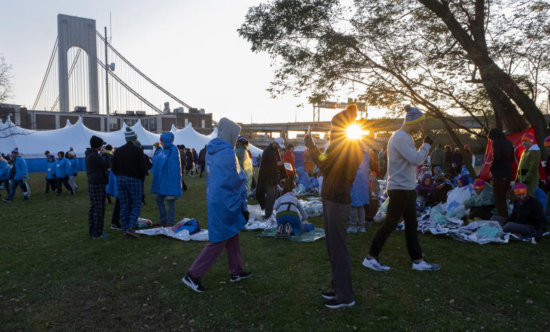 Runners wait near the Verrazano-Narrows Bridge before the New York City Marathon, Nov. 3, 2019, in New York. (Photo: Craig Ruttle/AP)