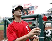 Washington Nationals pitcher Tanner Roark prepares to toss a signed ball back to a fan before a baseball game against the Atlanta Braves at Nationals Park on Tuesday, Aug. 6, 2013, in Washington. (AP Photo/Alex Brandon)