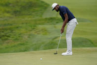 Tony Finau putts on the 17th green in the second round at the Northern Trust golf tournament, Friday, Aug. 20, 2021, at Liberty National Golf Course in Jersey City, N.J. (AP Photo/John Minchillo)