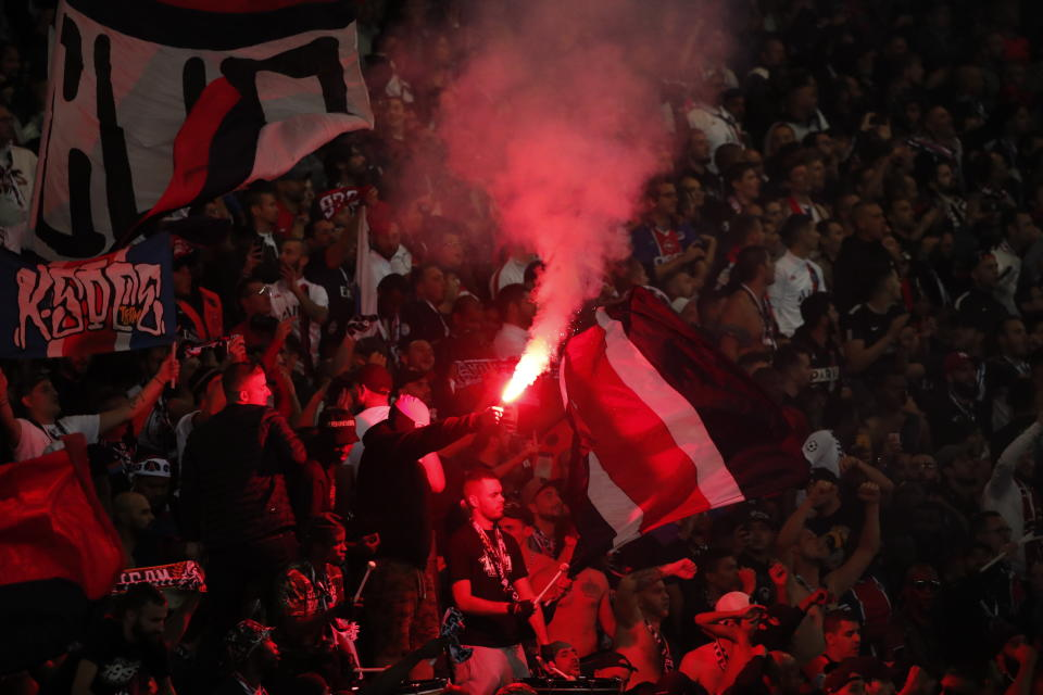 Paris Saint Germain's fans celebrate at the end of the Champions League group A soccer match between PSG and Real Madrid at the Parc des Princes stadium in Paris, Wednesday, Sept. 18, 2019. (AP Photo/Francois Mori)