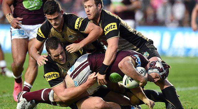 Jamie Buhrer (right) of the Sea Eagles is tackled by Isaah Yeo (left), Nathan Cleary (centre) and Trent Merrin. Source: AAP Image/Paul Miller