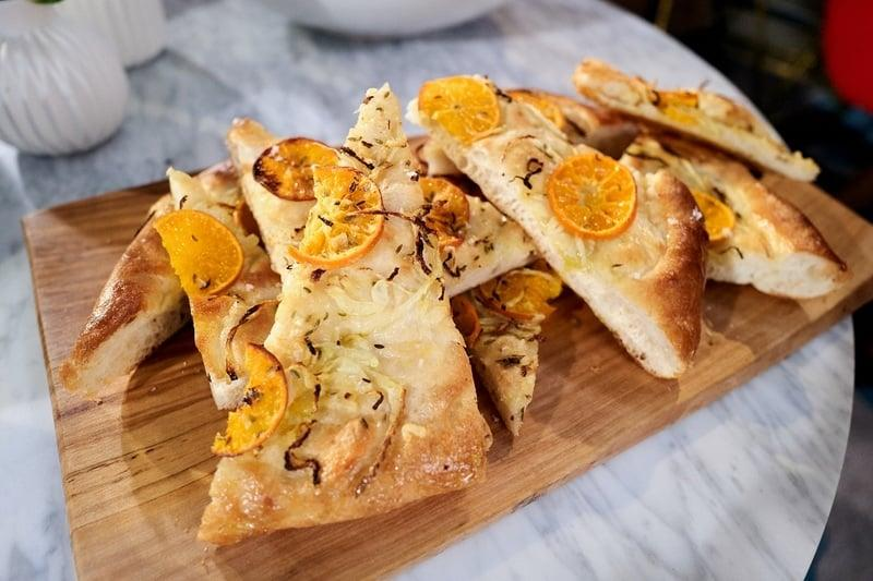 """<p><strong>Get the recipe:</strong> <a href=""""https://giadzy.com/posts/entertaining/holiday-handbook/437799/focaccia-with-fennel-and-clementine"""" target=""""_blank"""" class=""""ga-track"""" data-ga-category=""""Related"""" data-ga-label=""""https://giadzy.com/posts/entertaining/holiday-handbook/437799/focaccia-with-fennel-and-clementine"""" data-ga-action=""""In-Line Links"""">focaccia with fennel and clementine</a> </p>"""