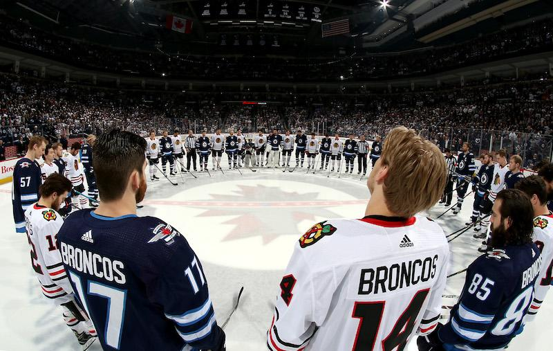 <p>Members of the Winnipeg Jets and Chicago Blackhawks stand together in solidarity for those killed in the deadly Saskatchewan bus crash at the Bell MTS Place in Winnipeg. Photo from Getty Images. </p>