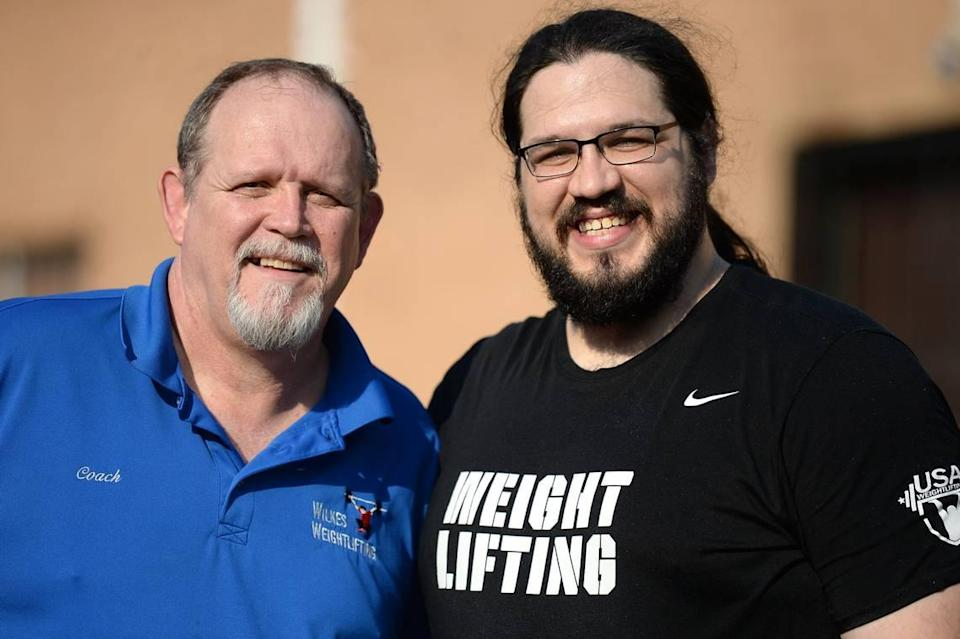 Chris Wilkes, left, was once a homicide detective in Virginia. Now he coaches his son, Caine Wilkes, an Olympic weightlifter.
