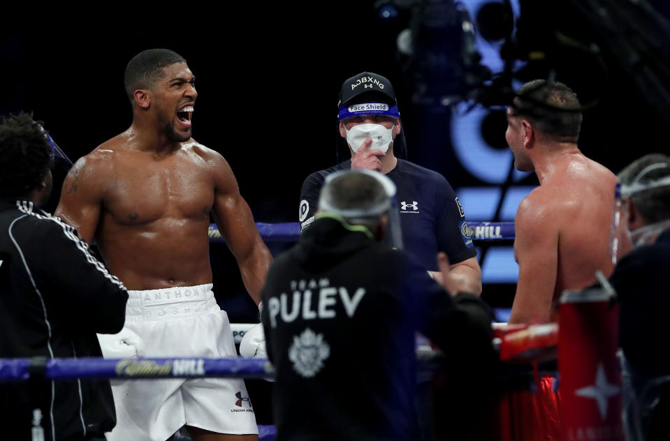 LONDON, ENGLAND - DECEMBER 12: Anthony Joshua reacts to victory over Kubrat Pulev during the IBF, WBA, WBO and IBO World Heayweight Title fight between Anthony Joshua and Kubrat Pulev at The SSE Arena, Wembley on December 12, 2020 in London, England. A limited number of fans (1000) are welcomed back to sporting venues to watch elite sport across England. This was following easing of restrictions on spectators in tiers one and two areas only. (Photo by Andrew Couldridge - Pool/Getty Images)