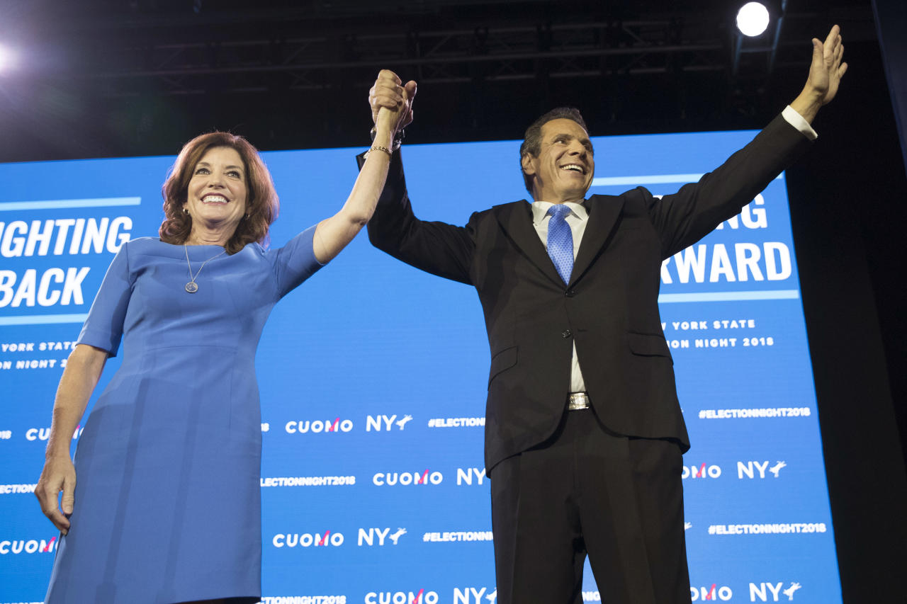 FILE - In this Tuesday, Nov. 6, 2018, file photo, New York Gov. Andrew Cuomo, right, stands with Lieutenant Governor Kathy Hochul during an an election night watch party hosted by the New York State Democratic Committee in New York. Democrats who gained new or expanded powers in state elections are gearing up for a left-leaning push on gun control, universal health care and legal marijuana. Meanwhile, some Republican legislatures that have cut taxes and limited union powers are adjusting to a new reality of needing to work with a Democratic governor. The midterm elections Tuesday, Nov. 6, increased Democratic relevance in state capitols that have been dominated by Republicans during the past decade. (AP Photo/Mary Altaffer, File)