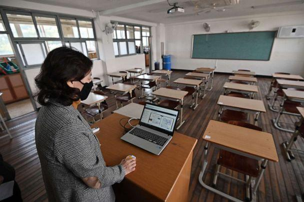 PHOTO: A teacher conducts an online class to her students at Seoul Girls' High School in Seoul, South Korea, on April 9, 2020, amid concerns over the novel coronavirus. (Jung Yeon-je/AFP via Getty Images)