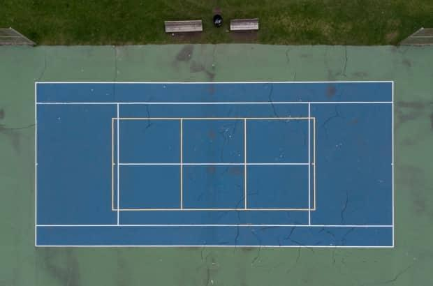 An empty tennis court is seen May 4, 2021 in Ottawa. Outdoor tennis courts are part of the Ontario government's stay-at-home measures.