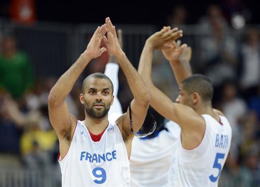French guard Tony Parker celebrates at the end of the men's preliminary round basketball match of the London 2012 Olympic Games on August 2, 2012 at the basketball arena in London. France won 82-74. AFP PHOTO / TIMOTHY A. CLARY