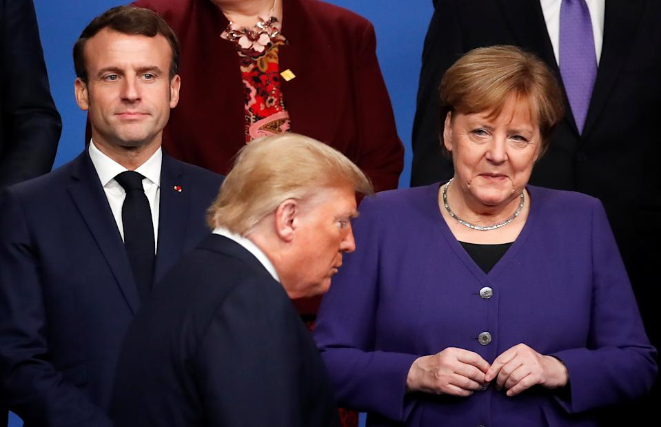 France's President Emmanuel Macron and Germany's Chancellor Angela Merkel look at U.S. President Donald Trump during a family photo opportunity at the NATO leaders summit in Watford, Britain December 4, 2019. REUTERS/Christian Hartmann/Pool