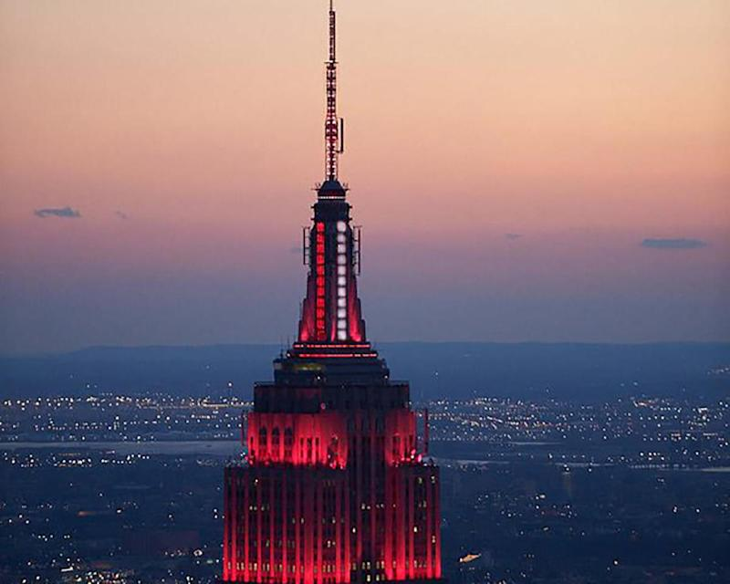 Empire State Building flashes red to honor first responders