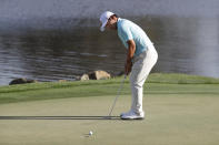 Sung Kang, of South Korea, sinks a birdie putt on the 18th hole during the second round of the Arnold Palmer Invitational golf tournament Friday, March 6, 2020, in Orlando, Fla. (AP Photo/John Raoux)